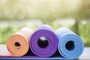 rolled up yoga mats exercise